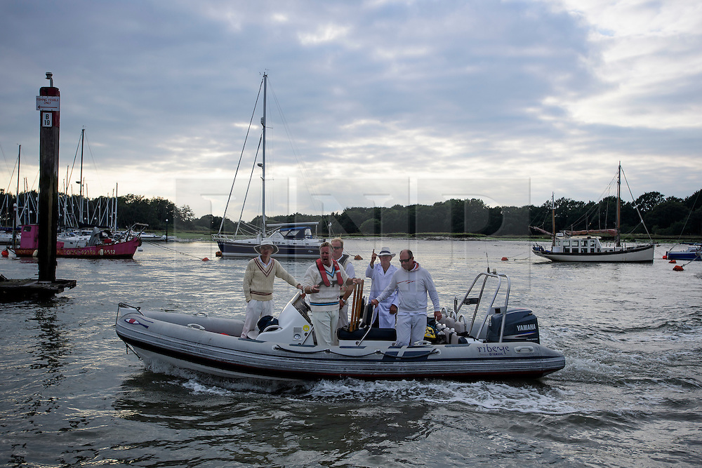 © Licensed to London News Pictures. 18/09/2016. Portsmouth, UK. Team members in a boat making their way to the bank. Teams take part in the  Bramble Bank Cricket Match in the middle of The Solent strait on September 18, 2016. The annual cricket match between the Royal Southern Yacht Club and The Island Sailing Club, takes place on a sandbank which appears for 30 minutes at lowest tide. The game lasts until the tide returns. Photo credit: Ben Cawthra/LNP