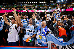 Suppoerters celebrate after Argentina win the match - Mandatory byline: Rogan Thomson/JMP - 07966 386802 - 18/10/2015 - RUGBY UNION - Millennium Stadium - Cardiff, Wales - Ireland v Argentina - Rugby World Cup 2015 Quarter Finals.