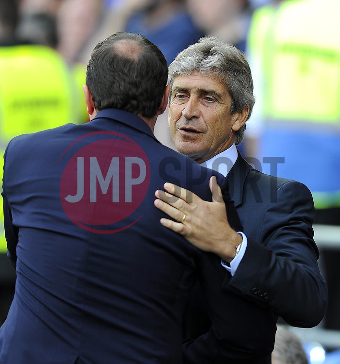 Manchester City Manager, Manuel Pellegrini is greeted by Cardiff City Manager, Malky Mackay  - Photo mandatory by-line: Joe Meredith/JMP - Tel: Mobile: 07966 386802 25/08/2013 - SPORT - FOOTBALL - Cardiff City Stadium - Cardiff -  Cardiff City V Manchester City - Barclays Premier League