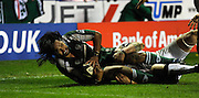 Twickenham, GREAT BRITAIN, Exiles' Seilala SEVEALI'I, is  tackled short of the line, during the Guinness Premiership match,  London Irish vs Newcastle Falcon at the Madjeski  Stadium, Reading. on Sat )3.01.2009. [Photo, Peter Spurrier/Intersport-images]