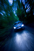 BMW car on country road in the dark, Gloucestershire, United Kingdom