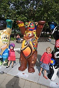 "United Buddy Bears exhibition in front of Karlskirche, Vienna. Angola, bear "" Mother N'gola"" by Moises Kuanza..An idea on its tour around the word: 137 Buddy Bears, created in Berlin/Germany, are standing peacefully hand in hand to represent 137 United Nations member states. An exhibition under the motto WE HAVE TO GET TO KNOW EACH OTHER BETTER it makes us understand one another better, trust each other more and live together more peacefully..The idea for this exhibition was created 2002 by the inventors of the Buddy Bears Eva and Klaus Herlitz. More than 140 artists, each one coming from the country his bear represents, show the art style of their home countries. Standing in a circle the bears form a unique work of art altogether. The individual design of each bear includes a lot of information about the different countries. Together with the symbolism of the circle love, peace, friendship, tolerance and international understanding are promoted. In each city where the circle is shown activities (e.g. auctions) raise money for children in need. .At the end of the world tour and in between the bears will be sold by charitable auction for UNICEF and other organisations helping needy children all over the world."