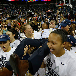 Apr 9, 2013; New Orleans, LA, USA; Connecticut Huskies head coach Geno Auriemma is carried by his players after the championship game in the 2013 NCAA womens Final Four against the Louisville Cardinals at the New Orleans Arena. Connecticut defeated Louisville 93-60. Mandatory Credit: Derick E. Hingle-USA TODAY Sports