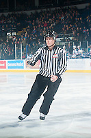 KELOWNA, CANADA - FEBRUARY 6: Linesman Dustin Minty skates the puck to the referee as the Kelowna Rockets take on the Kamloops Blazers on February 6, 2015 at Prospera Place in Kelowna, British Columbia, Canada.  (Photo by Marissa Baecker/Shoot the Breeze)  *** Local Caption *** Dustin Minty;