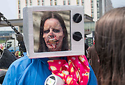 UNITED KINGDOM, London: 27 May 2016 A cosplay fan dressed as a zombie looks in the mirror of another cosplayer outside of the MCM London Comic Con held all this weekend at The ExCeL Centre. The comic convention will see an estimated 150,000 cosplay and comic fans flock to the exhibition. Rick Findler / Story Picture Agency