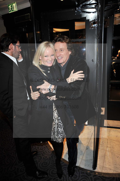 GENEVIEVE HOBERMAN and TIM ATTIAS at Quintessentially's 10th birthday party held at The Savoy Hotel, London on 13th December 2010.