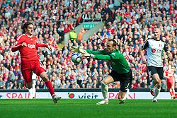 LIVERPOOL, ENGLAND - Sunday, April 11, 2010: Liverpool's Alberto Aquilani and Fulham's goalkeeper Mark Schwarzer during the Premiership match at Anfield. (Photo by: David Rawcliffe/Propaganda)