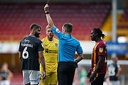 Referee Leigh Doughty shows a yellow card to Jordan Turnbull of Northampton Town   during the EFL Sky Bet League 2 match between Bradford City and Northampton Town at the Utilita Energy Stadium, Bradford, England on 7 September 2019.