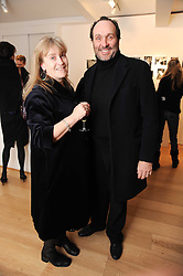 JOSEPHINE FARRELL and the HON.DAVID MACMILLAN at a private view of photographs by Nick Ashley held at the Sladmore Gallery, 32 Bruton Place, London on 13th January 2010.