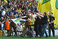Picture by Paul Chesterton/Focus Images Ltd.  07904 640267.11/03/12.The various Canaries supporters clubs parade their flags around the pitch at half time during the Barclays Premier League match at Carrow Road Stadium, Norwich.