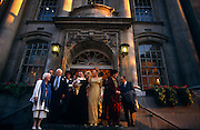 Relatives and friends stand on the steps of  the Chelsea registry office after a civil society wedding.