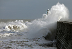Licensed to London News Pictures. 01/02/2015. A strong northerly wind and tide whip up massive waves that batter Tynemouth pier and the 26m high lighthouse. Photo credit: Adrian Don/LNP