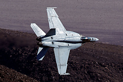 United States Navy Boeing F/A-18E Super Hornet (NH-307) from the VFA-146 Blue Diamonds squadron Naval Air Station Lemoore, flies low level through the Jedi Transition, Star Wars Canyon, Death Valley National Park, California, United States of America