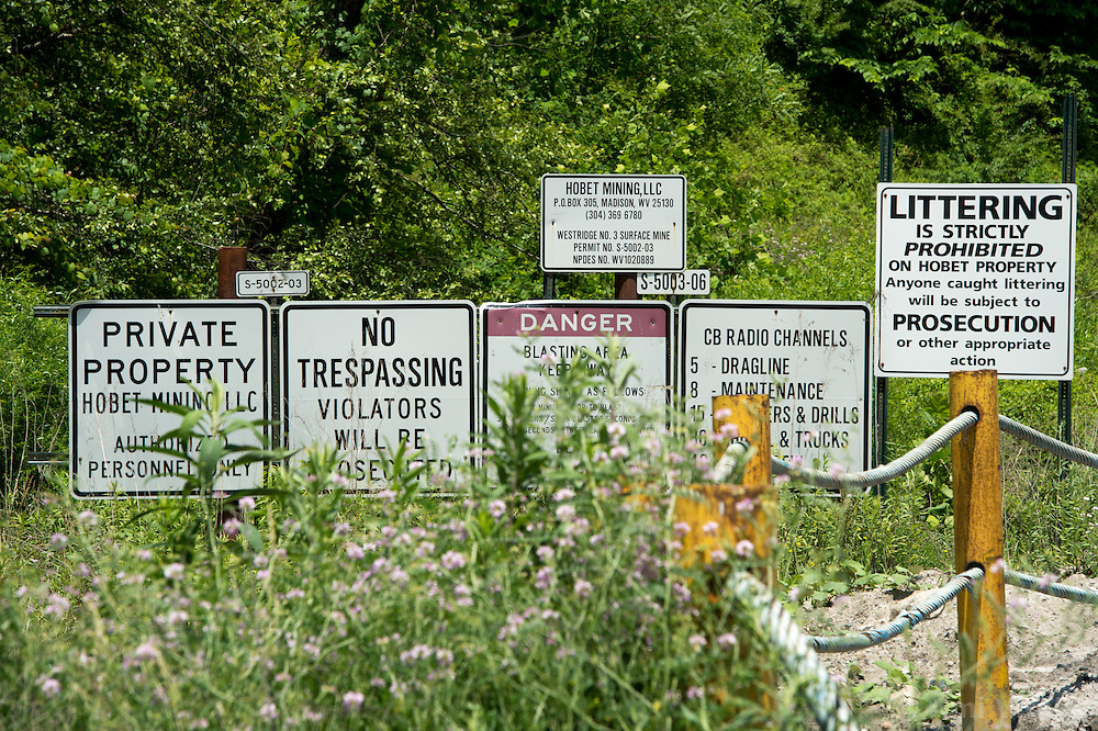 Signs are posted outside Hobet Mining's mountaintop mine in southern West Virginia. Mountaintop Removal is a method of surface mining that literally removes the tops of mountains to get to the coal seams beneath. It is the most profitable mining technique available because it is performed quickly, cheaply and comes with hefty economic benefits for the mining companies, most of which are located out of state. It is the most profitable mining technique available because it is performed quickly, cheaply and comes with hefty economic benefits for the mining companies, most of which are located out of state. Many argue that they have brought wage-paying jobs and modern amenities to Appalachia, but others say they have only demolished an estimated 1.4 million acres of forested hills, buried an estimated 2,000 miles of streams, poisoned drinking water, and wiped whole towns from the map.