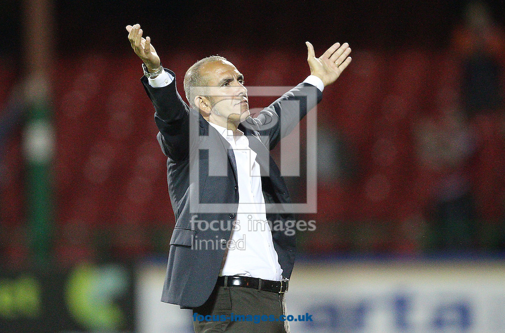 Picture by Paul Terry/Focus Images Ltd +44 7545 642257.14/08/2012.Paolo Di Canio, manager of Swindon Town reacts after Swindon score to make it 3-0 during the Capital One Cup match at the County Ground, Swindon.