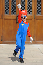 © Licensed to London News Pictures. 08/04/2017. London, UK. A young boy dressed as Mario joins participants taking part in the inaugural Games Character Parade, walking from Guildhall to Paternoster Square.  The event formed part of the London Games Festival welcoming cosplayers, wearing costumes inspired by videogame characters, to the UK's biggest parade of cosplayers.   Photo credit : Stephen Chung/LNP