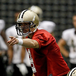 July 26, 2012; Metairie, LA, USA; New Orleans Saints quarterback Drew Brees (9) calls signals at the line during the first day of of training camp at the team's indoor practice facility. Mandatory Credit: Derick E. Hingle-US PRESSWIRE