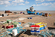 Fishing boats and equipment on the beach at Aldeburgh, Suffolk, England