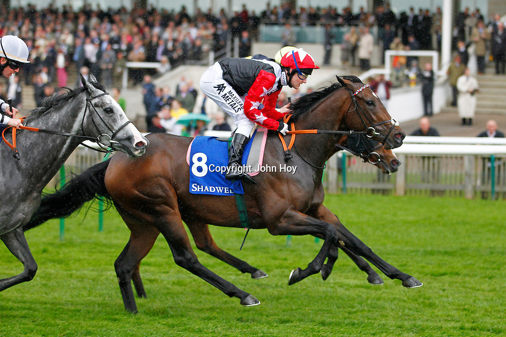 Chigun and Tom Queally winning the 1.45 Race