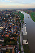 Nederland, Noord-Brabant, Cuijk, 15-11-2010;.Cuijk aan de Maas.  The village of Cuijk along the river Meuse. luchtfoto (toeslag), aerial photo (additional fee required).foto/photo Siebe Swart