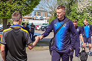 AFC Wimbledon striker Joe Pigott (39) fist bumping a young AFC Wimbledon fan during the EFL Sky Bet League 1 match between AFC Wimbledon and Bristol Rovers at the Cherry Red Records Stadium, Kingston, England on 19 April 2019.