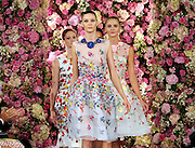 The Oscar de la Renta Spring 2015 collection is modeled during Fashion Week in New York, Tuesday, Sept. 9, 2014.  (AP Photo/Diane Bondareff)