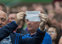 Football - 2017 / 2018 Premier League - West Ham United vs. Everton<br /> <br /> A disgruntled Everton fan holds a hand written note in protest after his team fall behind at the London Stadium<br /> <br /> COLORSPORT/DANIEL BEARHAM