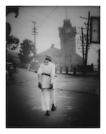 Man carrying umbrella, Darjeeling.