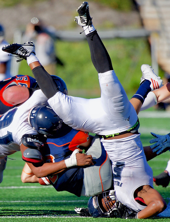 An unidentified Fullerton College player is uncerimoniously caught under a pile during there 35-14 win against Ocean Coast College.