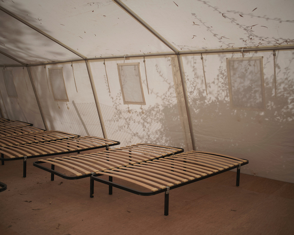 Bed frames in the medical tent at Villa Artemis, a shelter for 30 refugee women and their children in the grounds of Leros Hospital. <br /> <br /> Opened in September 2015, the shelter was run by the Leros Solidarity Network. However, Villa Artemis was closed down shortly after the opening of a 'Hotspot' (EU-run migrant's reception centres) camp in Lepida in February 2016. The medical tent was opened just three days before the villa was abandoned.