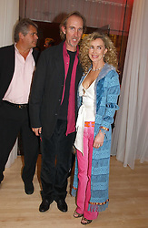 MIKE & ANGIE RUTHERFORD at the annual Laurent Perrier Pink Party held at The Sanderson Hotel, Berners Street, London on 27th April 2005.<br />