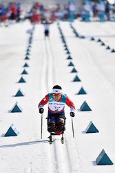 SIN Eui Hyun KOR LW12 competing in the ParaSkiDeFond, Para Nordic Skiing, Sprint at  the PyeongChang2018 Winter Paralympic Games, South Korea.