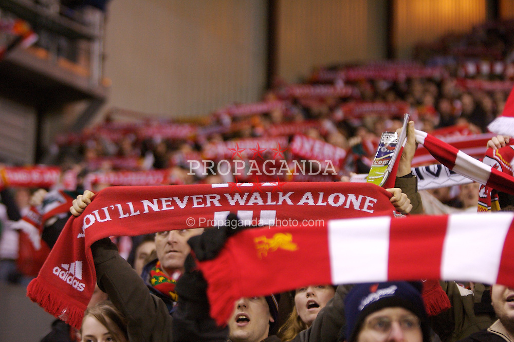 LIVERPOOL, ENGLAND - Tuesday, January 15, 2008: Liverpool's supporters celebrate their 5-0 victory over Luton Town holding their scarves up to sing 'You'll Never Walk Alone' during the FA Cup 3rd Round Replay at Anfield. (Photo by David Rawcliffe/Propaganda)