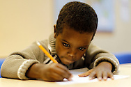 TREVOR HAGAN - Hamza, a 5 year-old student at the NEEDS Centre on Notre Dame, was barely able to hold a pencil three weeks ago when he first started attending the school. <br /> September 23, 2010