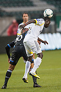 San Jose Earthquakes John Bostick (10 Black) and AIK Sweden Martin Kayongo-Matumba (9 White)in MLS preseason tournament action at Portland, Oregon's Jeld Wen Field. The game ended in a 0-0 draw.