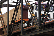A truck crosses a bridge intended for trains opened to road traffic to replace a  bridge that collapsed due to heavy rains near Notse, Togo on Friday September 11, 2009.