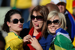 Three female South African fans pose for the camera as they watch the warm up, France v South Africa, FIFA World Cup 2010 Group A, Free State Stadium, Bloemfontein, South Africa, Date 22062010 Picture by Marc Atkins Mobile +27 8200 97621 (IPS PHOTO AGENCY) - 21 Delisle road - London SE28 0JD- tel: 020 88 55 1 008 - fax: 020 88 55 1037 - ISDN: 020 88 55 1039. / SPORTIDA PHOTO AGENCY