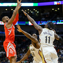 Mar 17, 2018; New Orleans, LA, USA; Houston Rockets guard Chris Paul (3) shoots over New Orleans Pelicans guard Jrue Holiday (11) and center Emeka Okafor (50) during the first quarter at the Smoothie King Center. Mandatory Credit: Derick E. Hingle-USA TODAY Sports