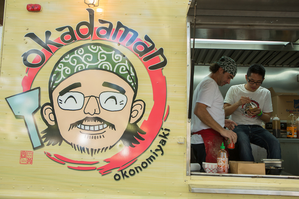 Two men from Okadaman, specialists in Japanese food, take a break in their truck at the end of the day. Okadaman was a finalist for Rookie of the Year.