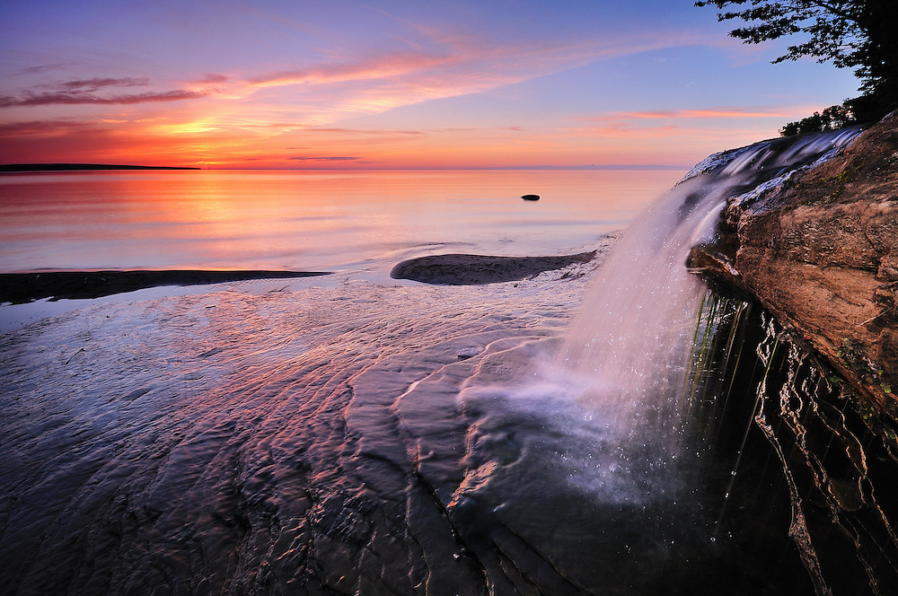 A Lake Superior sunset at Elliot Falls, Pictured Rocks National Lakeshore<br />