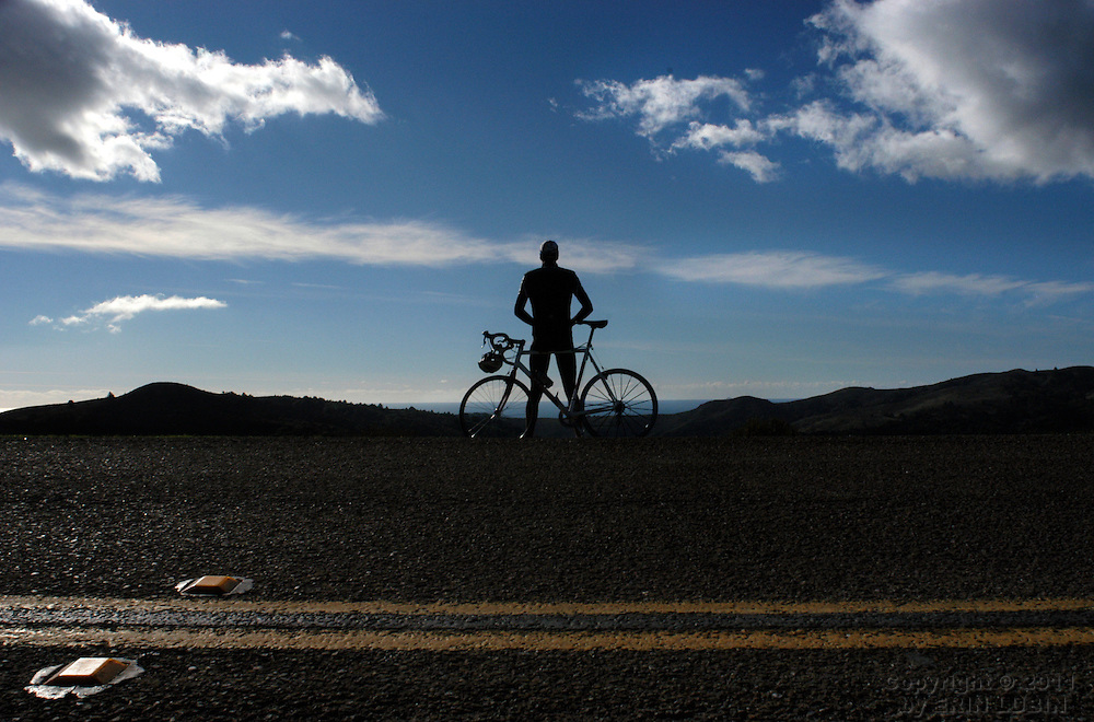 Tim Jernitis, a bicyclist from San Francisco, stops for a moment on the Panoramic Highway in Mill Valley during a ride Saturday afternoon, January 3, 2004. --- Erin Lubin --- Marin IJ -