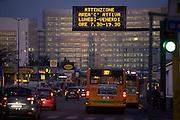 """A light panel indicates to motorists that the area """"C"""" is active from Monday to Friday from 7.30 am to 7.30 pm, Milan, February 2012. """"C"""" is an area in the city center accessible by car only by paying an entrance ticket of € 5. © Carlo Cerchioli..Un pannello luminoso segnala agli automobilisti  che l'area """"C"""" è attiva dal lunedì al venerdì dalle 7,30 am alle 7,30 pm, milano febbraio 2012. L'area """"C"""" al centro della città è accessibile in automobile solo pagando un ticket ingresso di 5€."""