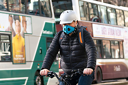 Edinburgh, Scotland, UK. 16 March, 2020. Effects of Coronavirus in Edinburgh City Centre today. Cyclist on Princes Street wearing a face mask. Iain Masterton/ Alamy Live News