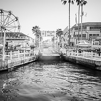 Newport Beach Balboa Island Ferry dock black and white photo with the Welcome to Balboa sign and Balboa Fun Zone Ferris Wheel. The Balboa Island Ferry transports cars and people across Newport Harbor between Balboa Island and Balboa Peninsula in Newport Beach California. Image Copyright © 2013 Paul Velgos with All Rights Reserved.