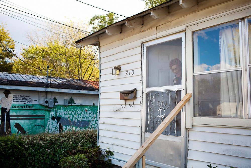 Margaret Aplin peers out her front door in the Baptist Town neighborhood of Greenwood, Mississippi on Friday, November 5, 2010.