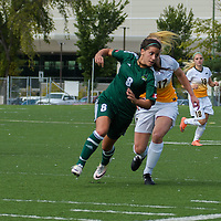 2nd year midfielder Jet Davies (17) of the Regina Cougars jostles with defender Kelsey Mitchell (8) of the Fraser Valley Cascades for possession during the Women's Soccer Homeopener on September 10 at U of R Field. Credit: Arthur Ward/Arthur Images