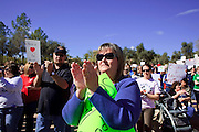 Feb 14, 2009 -- PHOENIX, AZ: People cheer for public school teachers during an education rally at the Arizona state capitol Saturday. About 1,000 people from across Arizona came to the State Capitol Saturday, Feb 14, to rally in favor of state funding for public schools and against budget cuts planned by the Arizona State Legislature. Arizona ranks 49th out of 50 states in per capita spending on public schools. Arizona is facing a massive budget deficit and legislators are expected to cut many state services, including public schools, to balance the budget.  Photo by Jack Kurtz / ZUMA Press