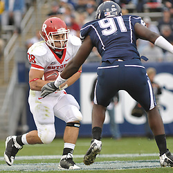 Oct 31, 2009; East Hartford, CT, USA; Rutgers running back Joe Martinek (38) looks for a way past Connecticut defensive end Jesse Joseph (91) during second half Big East NCAA football action in Rutgers' 28-24 victory over Connecticut at Rentschler Field.