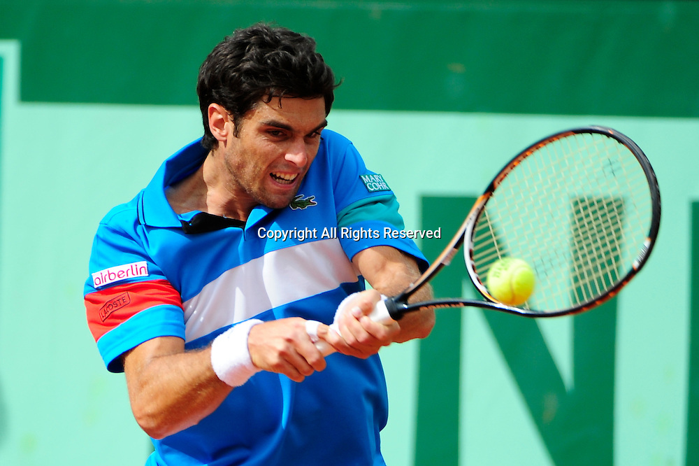 26.05.2011 French Open Tennis from Roland Garros Paris. Pablo Andujar of Spain returns a shot in his match against Rafael Nadal on day five of the French Open tennis championships.