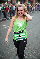 © Licensed to London News Pictures . 22/05/2016 . Manchester , UK . TINA O'BRIEN at the finishing line . The Great Manchester Run in Manchester City Centre . Photo credit : Joel Goodman/LNP